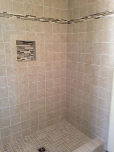 Fresh tile in this custom shower add a sense of luxury to this bathroom, done by Braendel in Erie, PA.
