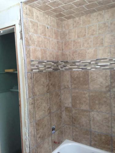 Shower is done in this custom bathroom. Next up: a fresh coat of paint and new floors!