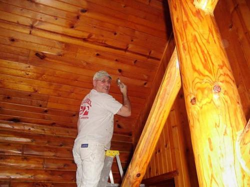 Working on restoring the wooden ceilings with delicate hands.