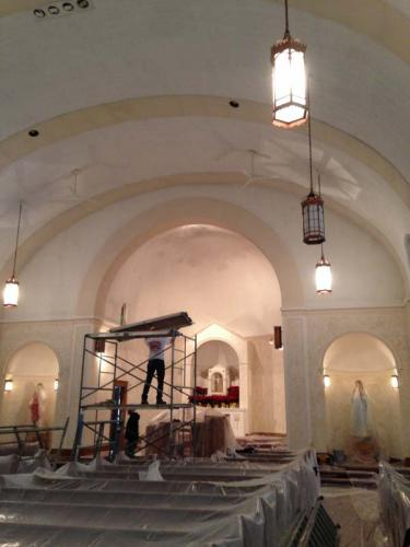 The pews are wrapped in plastic to protect them during this historical renovation project.