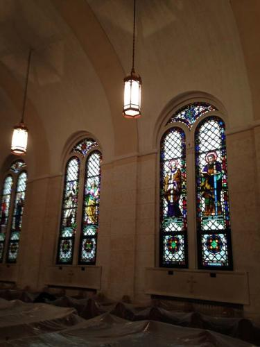The beautiful stained glass windows of this church shine brightly after a deep cleaning and restoration.