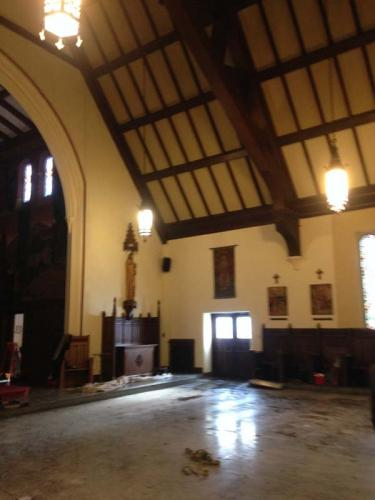 The interior of a church, without pews, prepped to undergo a historical renovation done by Braendel Services.