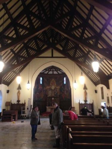Visitors review the progress on this historical church restoration lead by Braendel Services.