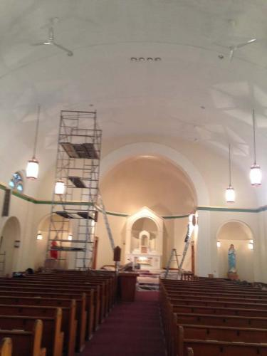 Scaffolding in a historical church helps crew members reach the ceiling during the restoration process.