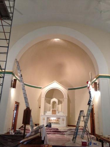 A professional interior renovator restores the alter area of a historical church.
