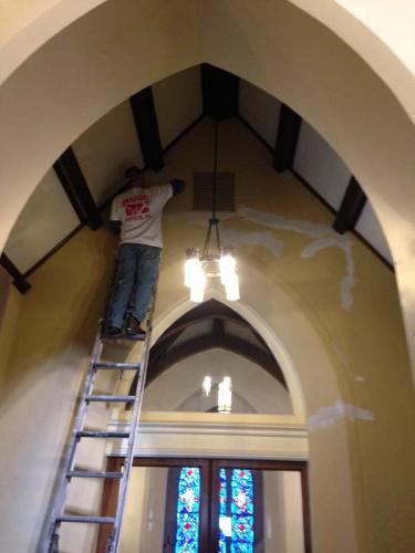 Fixing up the walls in an old church during the restoration process.