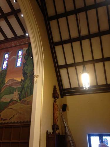 Look at how beautiful the ceiling beams and mural are in this restored church!