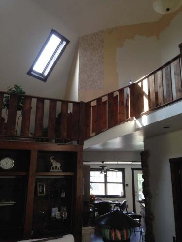 Prior to stripping the wallpaper and repainting the upstairs loft of this residential home.
