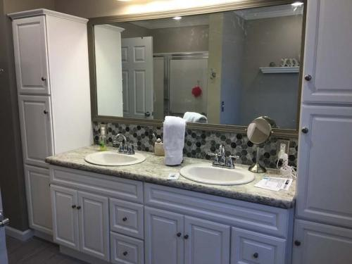 Twin sinks and plenty of storage space make this custom bathroom a favorite of homeowners in Erie, PA.