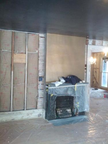This home remodeling project by Braendel Services included a restoration of the existing fireplace.