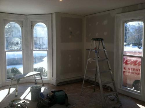 The walls in this gorgeous front room are almost ready for a paint job from the Braendel team.