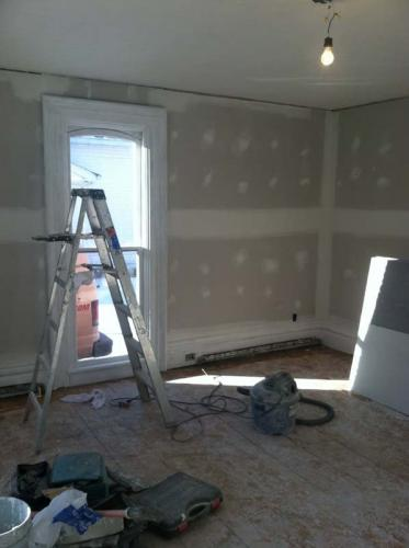 The walls of this room have been hung and prepped for fixtures and painting
