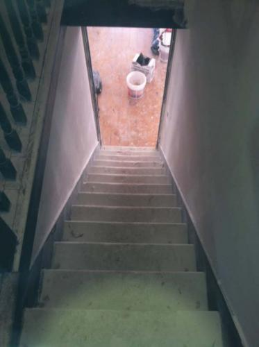 Looking down the staircase of a home being renovated by Braendel Services in Erie, PA.