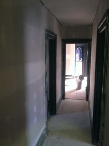 Looking down the hallway of home that is being completely remodeled by Braendel Services.
