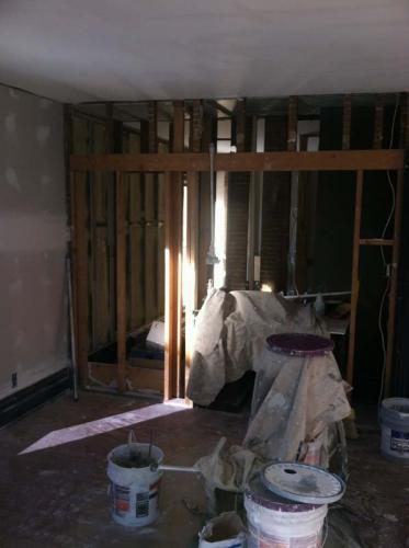 This room is partially constructed. On one wall you can see the drywall has been hung. On the other, there is just the framework.