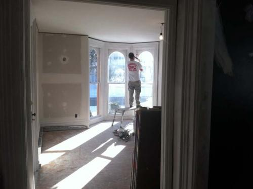Once the drywall has been installed, finishing touches are being put on by a Braendel team member before the paint and wallpaper.