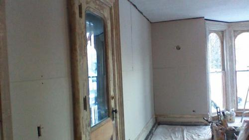Now that the drywall of this room has been added, it is ready for paint and new floors!