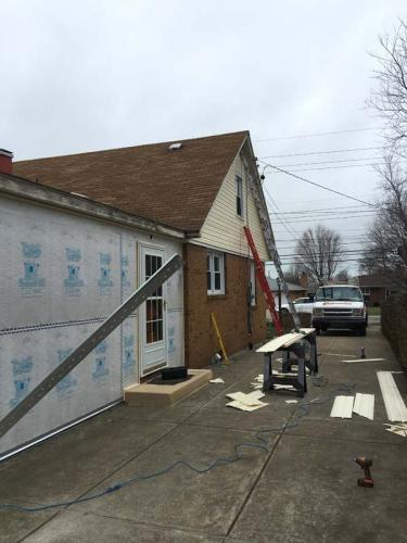 The Braendel team is changing the look of this entire house by installing new siding. The owners are going to love it.