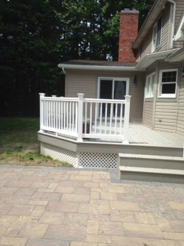 New siding (beige) by Braendel looks amazing when viewed from the side of this wrap-around porch.