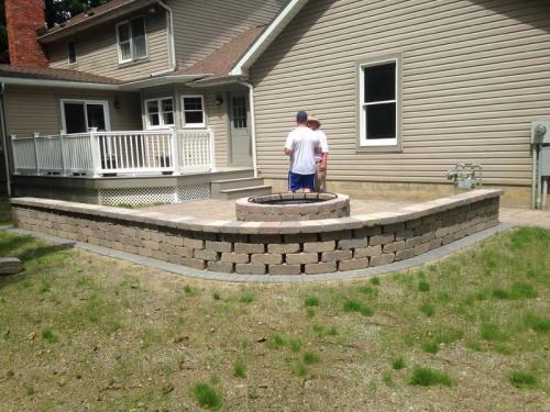 New masonry work enhances this custom-built firepit.