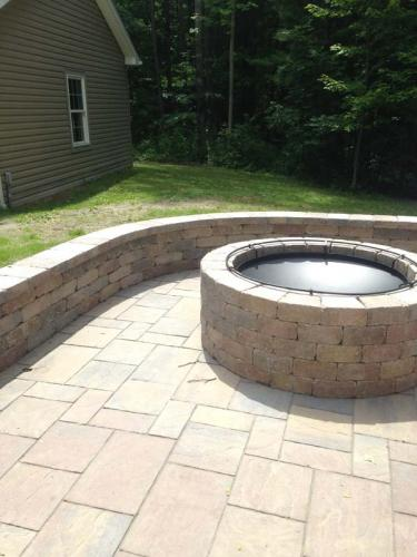 A firepit, rimmed by masonry, is a great addition to any backyard.