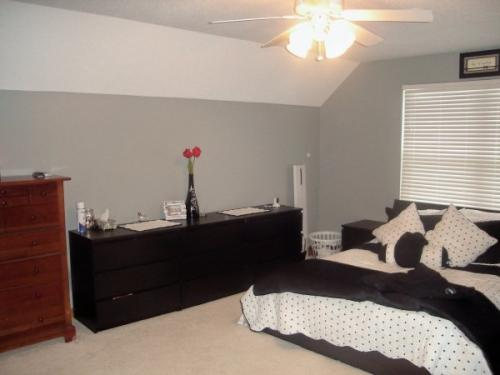 New paint on the walls (light gray) and ceiling (white) freshen up this bedroom.
