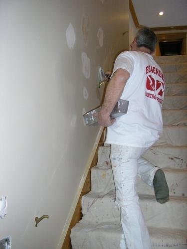 A Braendel crew member patches holes in the wall before getting started on an interior job. Paying attention to details like this ensures that the job is done perfectly!