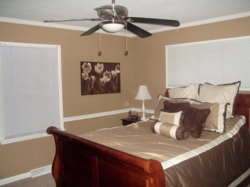 This bedroom is warm and inviting with a new paint job by Braendel. Don't you just want to fall asleep in these beige walls?