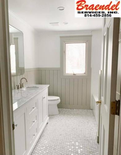 This finished custom bathroom is bright and beautiful thanks to the talented team at Braendel!
