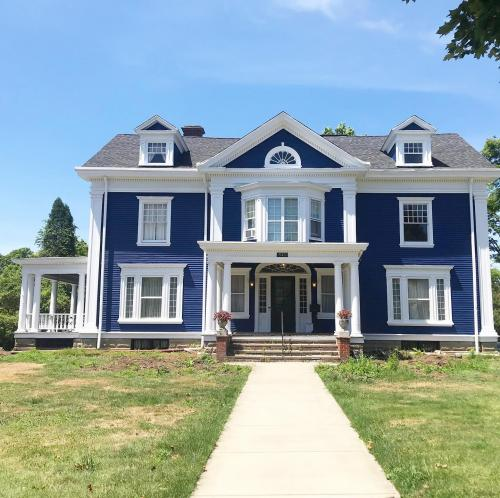 A gorgeous home stands back form the street, looking fresh with new siding installed by Braendel Services.