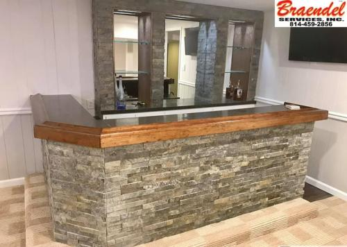 Custom work, such as this built-in bar, are one of the many things you can have Braendel install in your home or business.